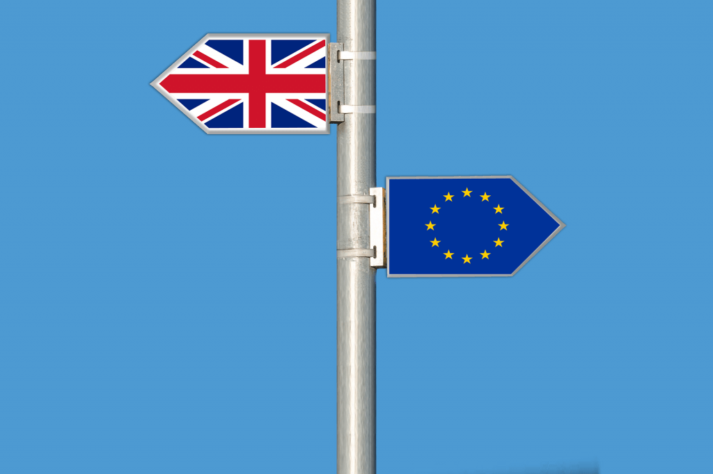 Road sign with UK and EU flags pointing in opposite directions