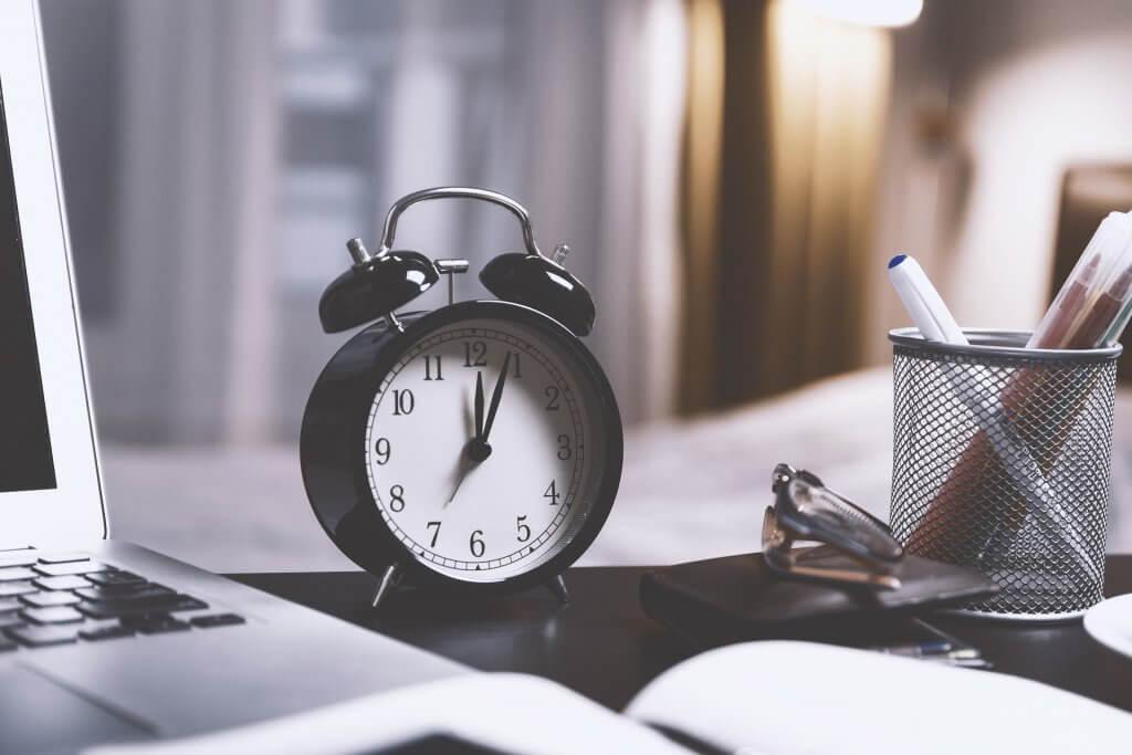 An alarm clock on a desk