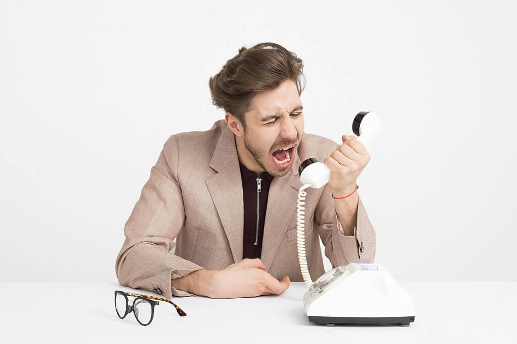 angry man shouting into phone